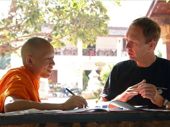 Winkeleigenaar Eric in Laos